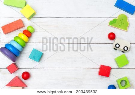 colorful wooden toys on white wooden background. Mockup