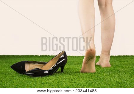Close Up Woman Walking For Relax On The Lawn,lower Legs Close Up,close Up Female Took Off Her High-h