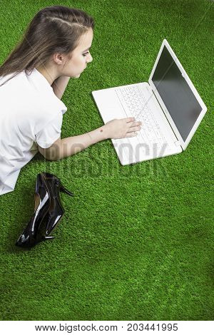 Attractive Young Woman Speaks On Mobile And Using Laptop Outside. Young Girl Took Off Her Shoes. Вac
