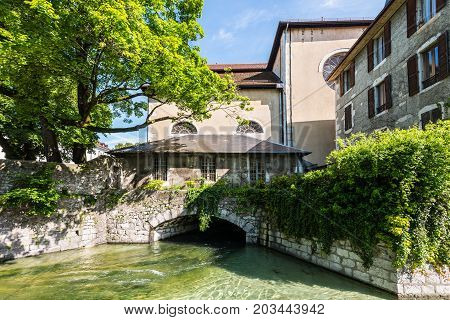 View of the canal under the building in city centre of Annecy capital of Haute Savoie province in France. Annecy is known to be called the French Venice.