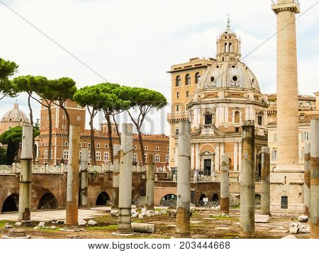 ROME, ITALY - AUGUST 30, 2013: Ruins of times of the Roman Empire and Church of the Most Holy Name of Mary at the Trajan Forum. Rome, Italy
