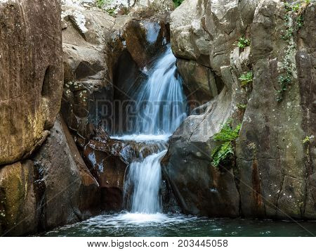 small waterfall in a green forest Rio de la Miel Algeciras Andalusia Spain