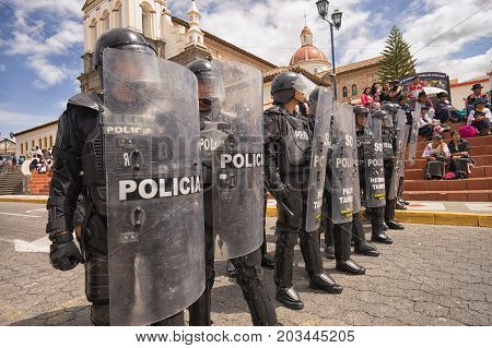 June 24 2017 Cotacachi Ecuador: riot police closing off access to a street at the Inti Raymi parade at summer solstice