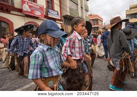 June 24 2017 Cotacachi Ecuador: indigenous kichwa children at the Inti Raymi parade at summer solstice