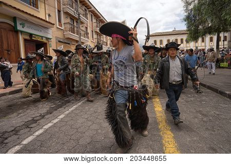 June 24 2017 Cotacachi Ecuador: indigenous kichwa men wearing chaps at the Inti Raymi parade at summer solstice
