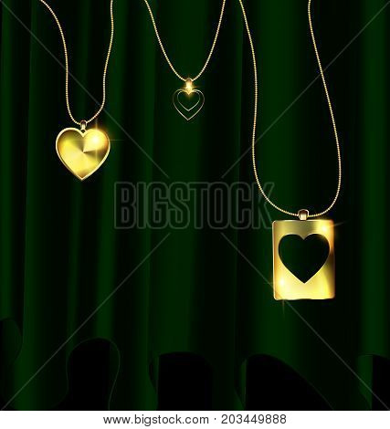dark background green drape and golden chain with three jewelry pendants heart