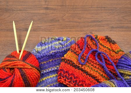 knit and wool on a wood close up photo