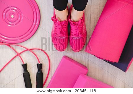 Beautiful athletic fitness woman with abdominal muscles. Part of fitness body. Sports and fitness - concept of healthy lifestyle. Young woman in the gym. Fitness girl with dumbbell