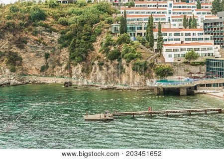 Budva, Montenegro - August 20, 2017: View of the modern beach town of Budva, Montenegro. Budva is one of the best and most popular resorts of the Adriatic Riviera. Beautiful beach at Budva's riviera.