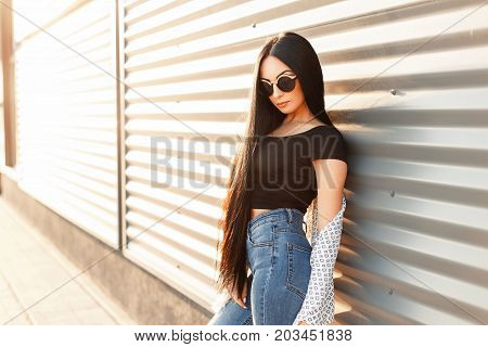 Beautiful Brunette Woman With Long Hair In Trendy Sunglasses With White Cloak And Black Jerseys In J