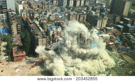 Downtown building demolition by controlled implosion in China