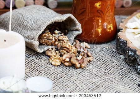Peeled walnut in a small baggy sack. Shallow focus.