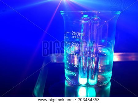 Chemical experiment. Glass flask filled with chemical solution. Chemical glass with transparent liquid. Medical research or chemical experiment concept image. Science banner template with text place