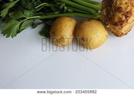 Traditional root vegetables celeriac and potatoes, horizontal aspect