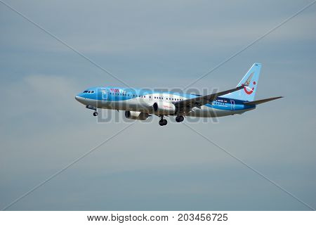 FRANKFURT, GERMANY - JUL 09th, 2017: TUIfly AIRLINES Boeing 737-800 lands at Frankfurt airport, Boeing 737 Next Gen, MSN 41660, Registration D-ATUN, TUIfly-a German leisure airline owned by the travel and tourism company TUI Group.