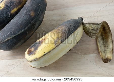 Fruits A Black Ripen Wild Banana Asian Banana or Cultivated Banana on A Wooden Table.