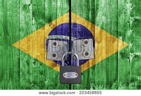 Brasil flag on door with padlock close