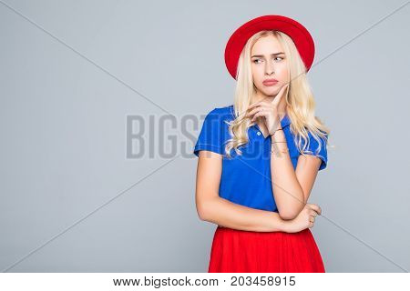 Portrait Of Stylish Smiling Pretty Woman In Red Hat And Spectacles Touching Her Chin With Hand On Gr