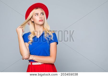 Portrait Of A Stunning Fashionable Lady In Bright Red Dress Posing Over Gray Background. Colors Of S