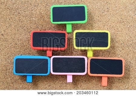 Empty wood sign on wooden cork background for input text in your want and have copy space.