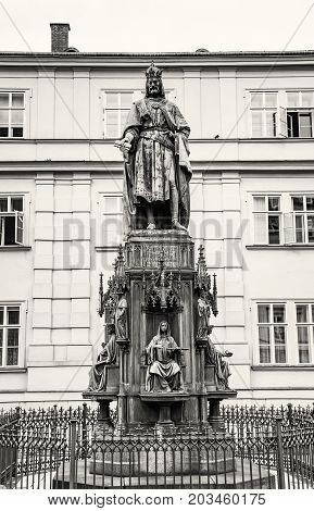 Old statue of Charles IV Prague Czech republic. Architectural theme. Black and white photo.