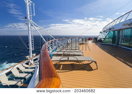 Sun loungers on the upper deck of a luxury cruise liner at sea