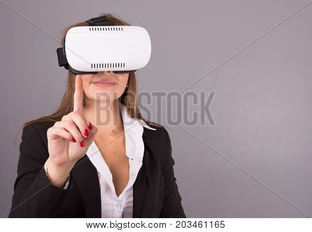 Business Woman In Wearable Technology Vr Glasses. Confident Young Woman In A Business Suit In Virtua