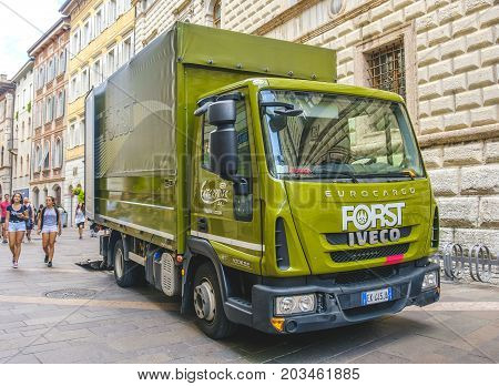Trento Italy 14 Aug 2017 - A green Forst beer truck in the streets of Trento city. Forst beer is a famous south tyrolean beer brand