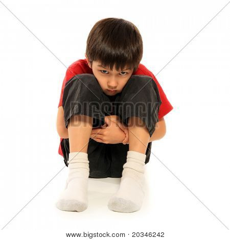 Depressed young boy over white background