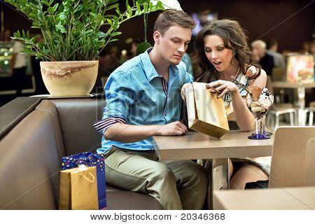 Happy couple enjoying their shopping