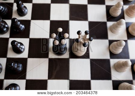 Black And White King Of Chess Set Up On Dark Background .