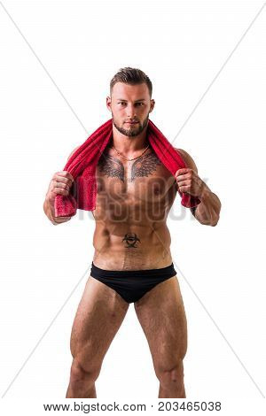 Handsome shirtless muscular man in briefs, standing, isolated on white background