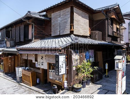 JAPAN, KYOTO, APRIL, 05, 2017 - Traditional ancient Japanese wooden house with roof tile ornamentation in the old district of Gion, Kyoto, Japan. Gion is Kyoto`s famous geisha district.