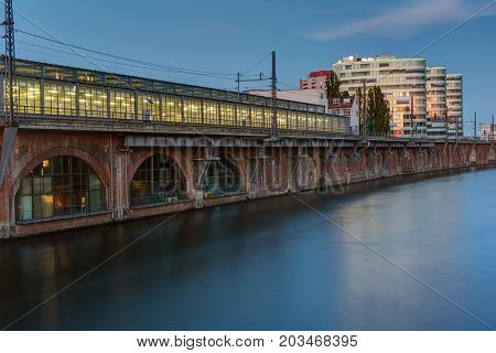 Trainstation at the river Spree in Berlin at dusk