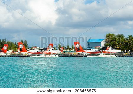 MALE MALDIVES - JULY 04 2017: hydroplane near the wooden pier at the Male