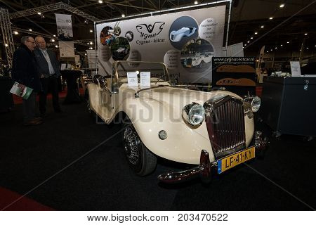 MAASTRICHT NETHERLANDS - JANUARY 09 2015: Modern car in retro style Cygnus Kitcar built on the basis of the Citroen 2CV 2001. International Exhibition InterClassics & Topmobiel 2015