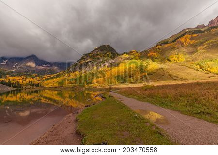 a scenic reflection of the maroon bells in autumn