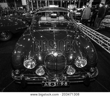MAASTRICHT NETHERLANDS - JANUARY 09 2015: A sports saloon Jaguar Mk 2 County Prototype 1962. Black and white. International Exhibition InterClassics & Topmobiel 2015