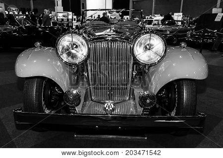 MAASTRICHT NETHERLANDS - JANUARY 09 2015: A sports car Jaguar SS1 Tourer 1934. Black and white. International Exhibition InterClassics & Topmobiel 2015
