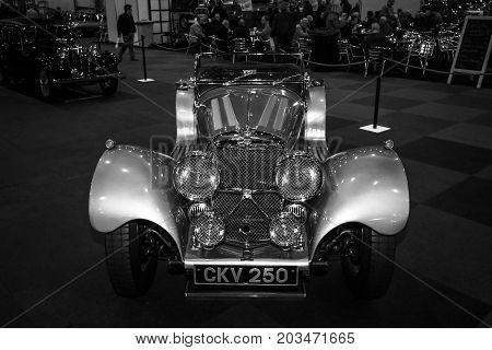 MAASTRICHT NETHERLANDS - JANUARY 09 2015: A sports car Jaguar SS100 3.5 1937. Black and white. International Exhibition InterClassics & Topmobiel 2015