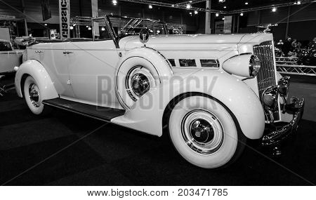 MAASTRICHT NETHERLANDS - JANUARY 09 2015: Oldtimer Packard 120 Convertible Sedan with Dietrich Body 1937. Black and white. International Exhibition InterClassics & Topmobiel 2015