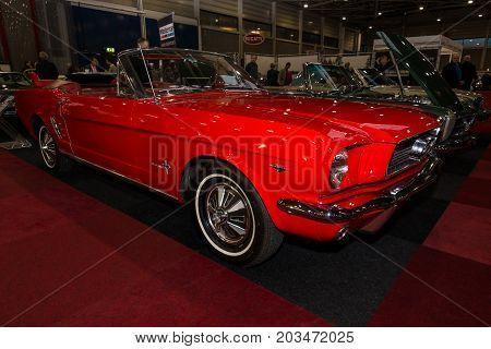 MAASTRICHT NETHERLANDS - JANUARY 09 2015: Pony car Ford Mustang Cabrio 1966. International Exhibition InterClassics & Topmobiel 2015