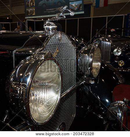 MAASTRICHT NETHERLANDS - JANUARY 08 2015: Hood ornament Goddess of Speed (donuts chaser) of a Packard 845 Boatteil Roadster by Bohman & Schwartz 1931. International Exhibition InterClassics & Topmobiel 2015