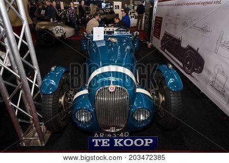 MAASTRICHT NETHERLANDS - JANUARY 09 2015: Custom car - race car Jaguar XK150 Vicarage Speciale on the basis of a sports car Jaguar XK150 FHC 1959. International Exhibition InterClassics & Topmobiel 2015