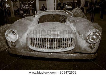 MAASTRICHT NETHERLANDS - JANUARY 09 2015: The remains of a body of fiberglass sports car Glasspar G2 1949. Sepia. International Exhibition InterClassics & Topmobiel 2015