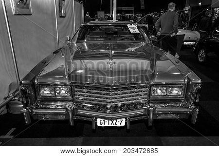 MAASTRICHT NETHERLANDS - JANUARY 09 2015: Full-size personal luxury car Cadillac Eldorado Biarritz 1976. Black and white. International Exhibition InterClassics & Topmobiel 2015