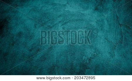 Beautiful Abstract Grunge Decorative Turquoise Dark Wall Background. Art Rough Stylized Texture Web Banner With Space For Text. Textured background with bright center spotlight