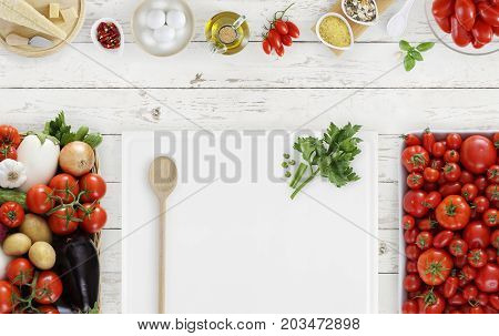 cooking concept food above white cutting board with vegetables tomatoes and food ingredients on kitchen white worktop copy space top view