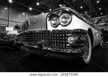 MAASTRICHT NETHERLANDS - JANUARY 09 2015: A full-size car Buick Century Riviera convertible 1958. Black and white. International Exhibition InterClassics & Topmobiel 2015