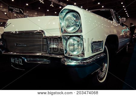 MAASTRICHT NETHERLANDS - JANUARY 09 2015: Detail of a full-size luxury car Cadillac Sixty Special (Ninth generation). Vintage toning. Stylization. International Exhibition InterClassics & Topmobiel 2015